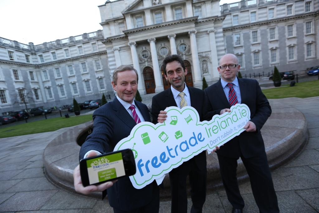 An Taoiseach Mr Enda Kenny, T.D launches the FreeTrade Ireland Smartphone App with Shane Colgan (EPA) and Hugh Coughlan ( Dublin City Council)